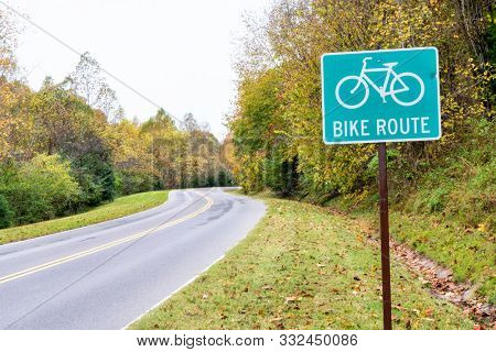 Bike route sign on Natchez Trace National Parkway in fall scenery, travel and recreation concept