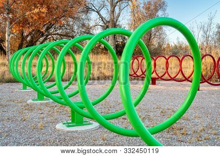 colorful spiral shaped bike racks along a trail in Fort Collins, Colorado in late fall scenery - outdoor activity and bike commuting concept