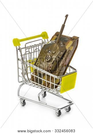 Toy panzer in shopping cart isolated on white background