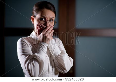 Girl In A White Shirt Closes Her Mouth With Hands With An Expression Of Fear On Her Face, Woman In F