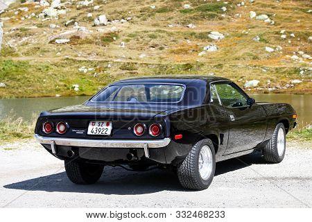Saint Gotthard Pass, Switzerland - September 14, 2019: Black Retro Coupe Car Plymouth Barracuda In T