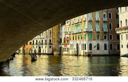 Venice, Italy - June 2, 2019: A Lone Gondola Approaches On The Grand Canal Underneath The Famed Rial
