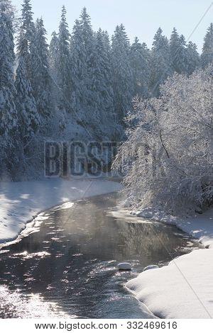 Steamy Creek In Deep Snow An Bright Morning Light