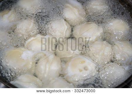 Dumplings In Boiling Water. Meat Dumplings Are Boiled In A Pot Of Boiling Water.