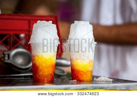 Street Vendor In The City Of Cali In Colombia Preparing And Selling A Traditional Sweet Water Ice Ca