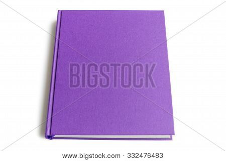 The Top Side Of The Purple Hardcover Book Isolated On White Background With Copy Space For Text.