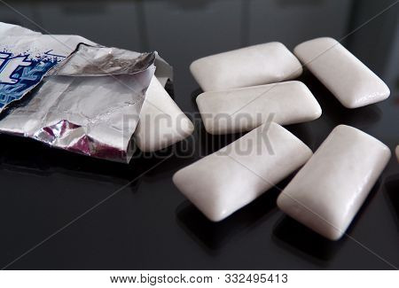 Chewing Gum To Freshen Your Breath. Chewing Gum Poured From A Pack Of Gum Close-up. Cleaning The Mou