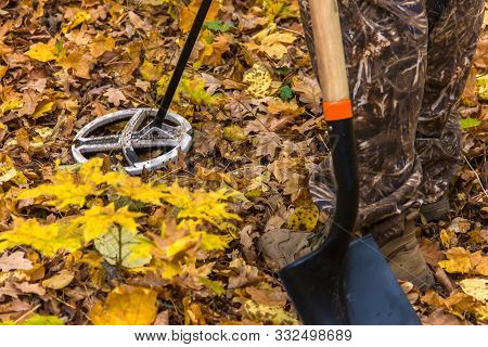 Metal Detector At Work In The Forest. Search For Treasure And Ancient Values. Archeology. Man With A