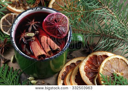 Christmas Background. Mulled Wine In A Vintage Green Mug. Mulled Wine With Traditional Spices And Dr