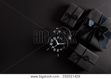 Top View Of Black Friday Sale Text With Black Gift Box With Alarm Clock On White Background. Shoppin