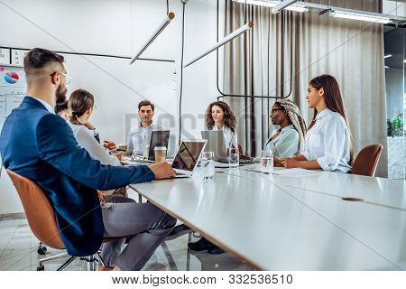 Concentration At Work. Young Business People Work In A Spacious Beautiful Office Together. Group Of