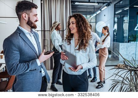 Business Professionals. Group Of Young Confident Business People Talking With Each Other In The Offi