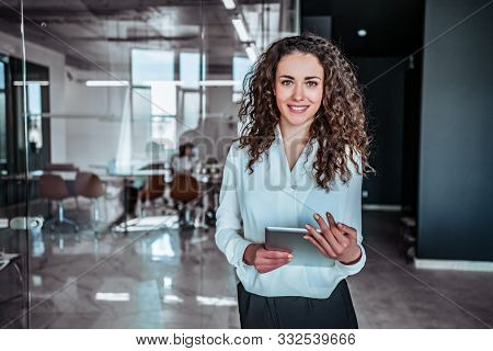 Modern Business Woman With Digital Device In Office