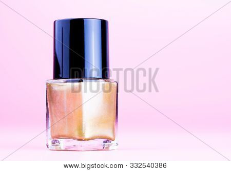 Nice Bottle Of Gold Nail Polish, Pink Background