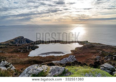 Sunset Above The Lake At Slieve League Cliffs Which Are Among The Highest Sea Cliffs In Europe Risin