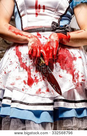Bloodied Knife In The Hands Of A Girl.