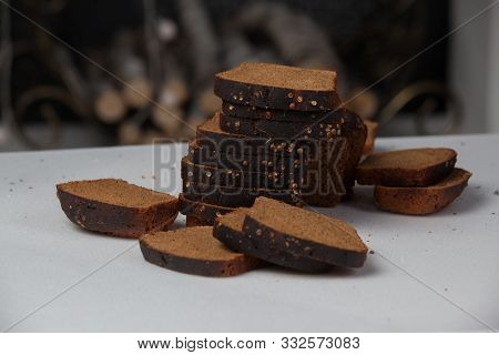 Fresh Baked Bread And Sliced Bread On Rustic Table