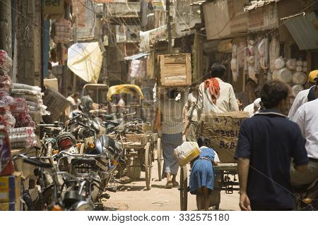 Varanasi, Uttar Pradesh, India - July 07, 2011: Crowded Streets Of Indian Cities - Overpopulation/tr