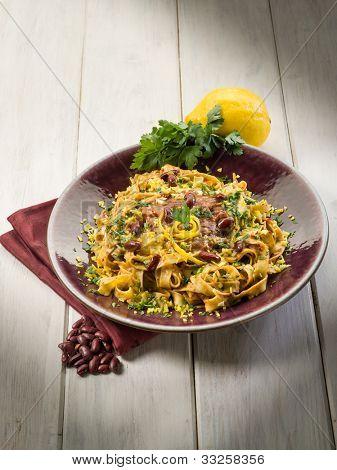 pasta with beans sauce grated lemon peel and parsley, vegetarian food