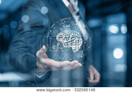 The Concept Of Brainstorming. Businessman Showing A Brain.