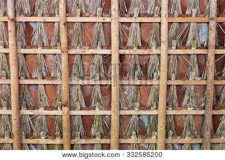 Roof Of Farm Shed With Tiles, The Gates Are Filled With Bunches Of Reed To Make The Roof Draught-fre