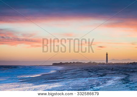 Cape May Nj Lighthouse And Atlantic Ocean At Sunset In Springtime With Beautiful Pink, Purple And Or