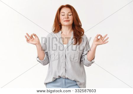 Relaxed Middle-aged Carefree Redhead Woman Exercise Yoga Breathing Practice Gather Patience Release