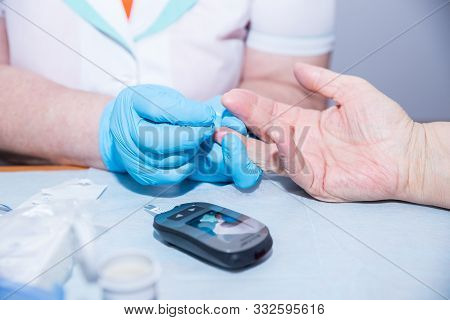 Medical Nurse Measuring The Blood Sugar With Modern Medicine.checking Senior Patients Blood Sugar.wo