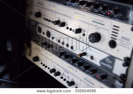 A Rack Of Audio Compressors In A Recording Studio.