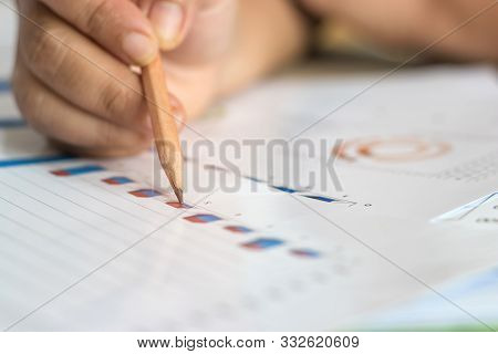 Data Analysis And Project Management Concept. Asia Businesswoman Analyzing Statistics And Working Wi