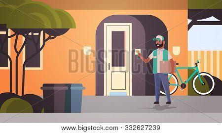 Courier Man Delivering Cardboard Parcel Ringing House Doorbell Express Delivery Service Concept Hori