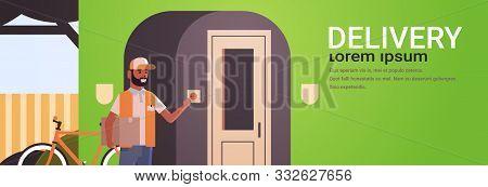 African American Courier Man Delivering Cardboard Parcel Ringing House Doorbell Express Delivery Ser
