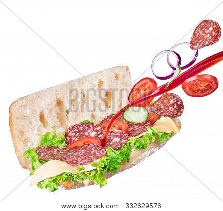 Sandwich With Falling In Ciabatta Bread Salami And Splashing Ketchup. Fast Food With Flying Ingredie