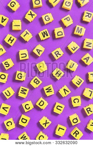 Dyslexia Word Yellow On Pink Purple With Scattered Letters Cubes Around, Reading Difficulty And Diso