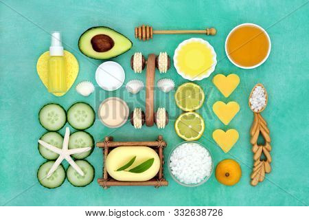Beauty treatment for skincare with avocado, lemon and cucumber with spa, exfoliation, moisturising and  cleansing products. Flat lay.