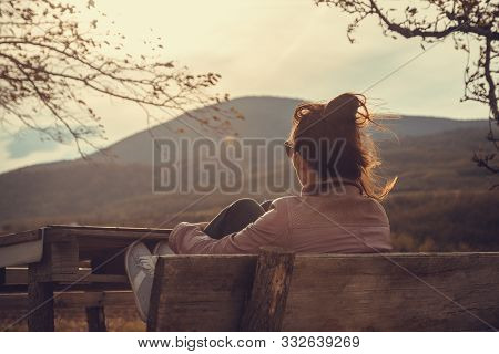 Woman In Nature In Sunset. People In Nature.beautiful Woman Relaxing In Nature In Sunset. Beautiful