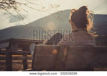 Woman In Nature In Sunset. People In Nature.. Beautiful Woman Relaxing In Nature In Sunset. Beautifu