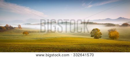 Fall In Slovakia. Meadows And Fields Landscape Near Poniky. Autumn Colored Trees At Sunrise