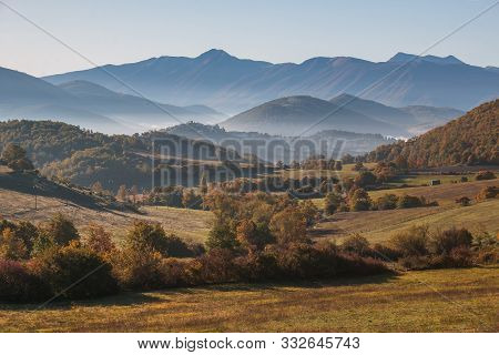 Morning View Of Monteleone Di Spoleto Medieval Village With Fog On Autumn Day