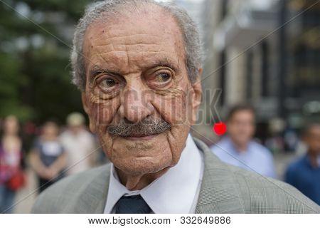 Sao Paulo, Brazil - December 16, 2015: Elegant Senior Man At Paulista Avenue, The Most Important Fin