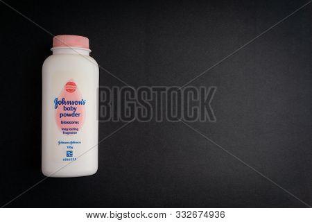 Kuala Lumpur, Malaysia- November 9, 2019: Bottle Of Johnson & Johnson Baby Powder On Black Backgroun