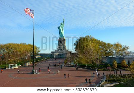 NEW YORK, NY - 04 NOV 2019: Statue of Liberty and Flagpole plaza seen from the Muueum on Liberty Island.