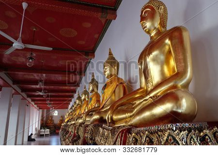 Bangkok, Thailand, December 25, 2018 A Series Of Gilded Buddha Statues On Display For Pilgrims In On