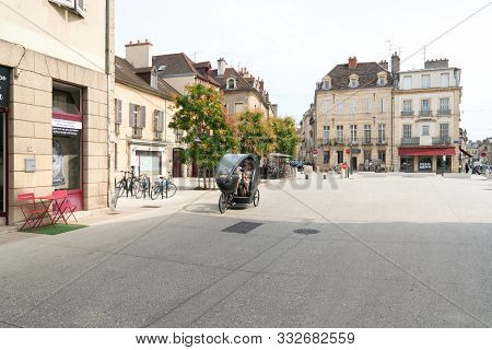 Electric Bicycle Taxi Transporting Senior Citizens Through The Historic Old Town Of Dijon In Burgund