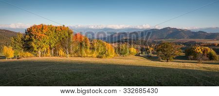Fall In Slovakia. Meadows And Fields Landscape Near Povraznik. Autumn Colored Trees At Sunrise