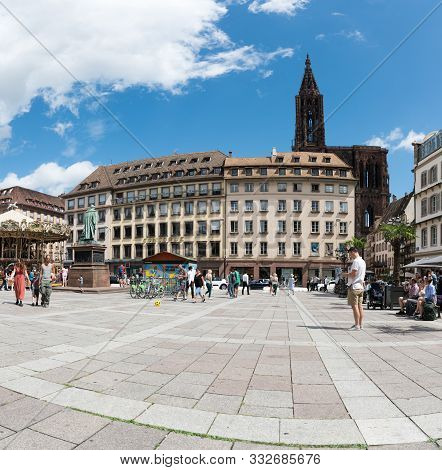 Tourists Enjoy A Visit To Picturesque Historic Old Town Strasbourg On A Summer Day