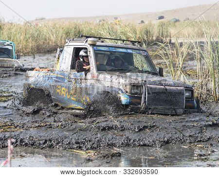 Almaty, Kazakhstan - September 29, 2019: Off-road Jeep Competition. Dirt And Splash Of Water In Off-