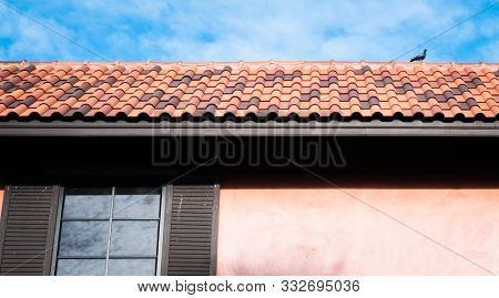 Roof Top On Sky Background. Close Up Of Brown Clay Roof Tiles. Red Old Dirty Roof. Old Roof Tiles. C