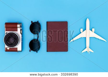 Flat Lay Image Of Accessory Clothing To Plan Travel In Holiday On Blue Background, Travel Concept, O