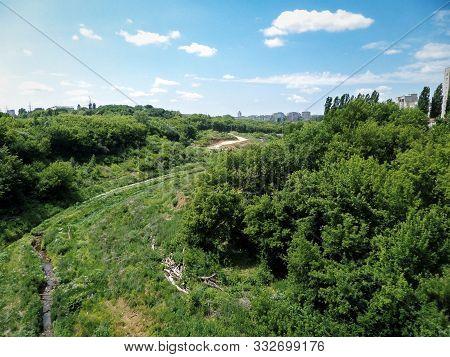 Stream At The Bottom Of A Green Ravine. 18 June 2019 Year. Russia. City Lipetsk. Stone Log Ravine.